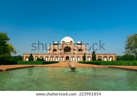 View of the Humayun's Tomb, Delhi, India. Humayun's Tomb is one of Delhi's most famous landmarks. The monument has an architectural design similar to the Taj Mahal. - stock photo