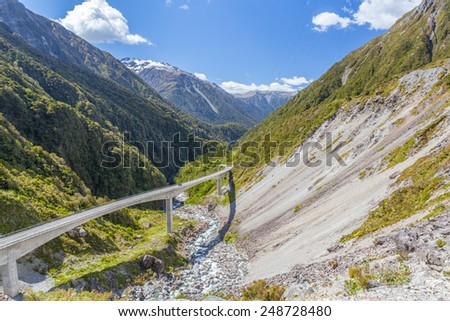 View of the impressive Arthurs Pass Bridge, Arthur's Pass, Canterbury, New Zealand - stock photo