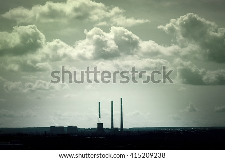 View of the industrial city and the sky with clouds
