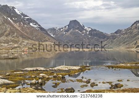 View of the island-studded rugged coastline at Valberg on the island Vestvagoy - stock photo