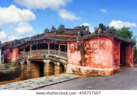 View of the Japanese Covered Bridge (Cau Chua Pagoda, Cau Nhat Ban, Lai Vien Kieu), Hoi An Ancient Town (Hoian), Vietnam. Blue sky in background. The old bridge is a popular tourist attraction of Asia