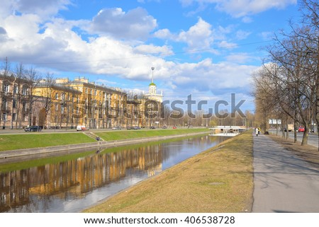 View of the Komsomol channel and Kolpino town at spring sunny day on the outskirts of St. Petersburg, Russia.