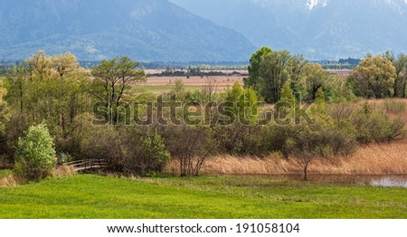 "View of the landscape at ""Murnau"" near Munich in the Alps of Bavaria in the springtime - stock photo"