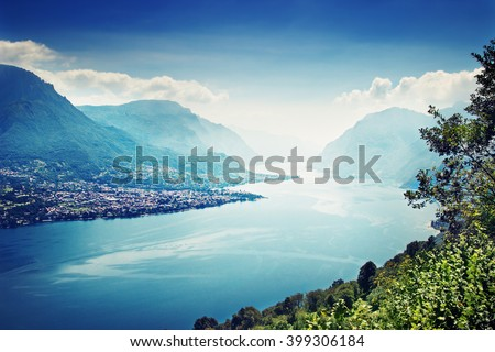 View of the landscape with tranquil Como lake and the Alps in summertime, Italy.