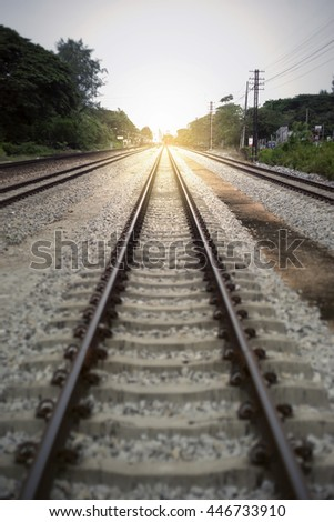 "view of the length of railway with green tree at left and right side of railway,filtered image, light effect added, selective focus, mean ""There light at the end of the tunnel"", success way - stock photo"