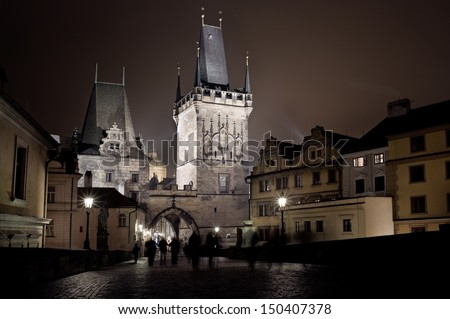 View of the Lesser Bridge Tower of Charles Bridge in Prague (Karluv Most) the Czech Republic. - stock photo