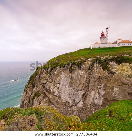 View of the lighthouse and cliff to the ocean, Cabo da Roca, Sintra, Portugal - stock photo