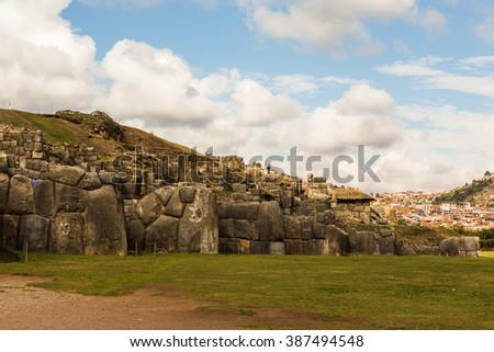 View of the longest stone wall in the ancient Inca settlement in the background of mountains in the province of Cusco, Peru