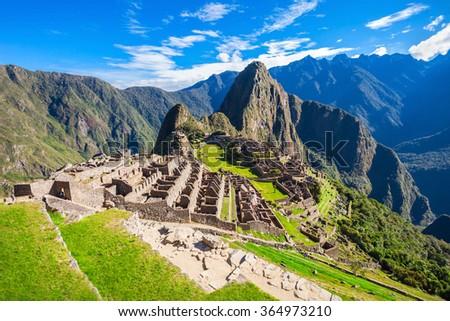 View of the Lost Incan City of Machu Picchu near Cusco, Peru. Machu Picchu is a Peruvian Historical Sanctuary and a UNESCO World Heritage Site. Machu Picchu is  located in the Cusco Region in Peru. - stock photo