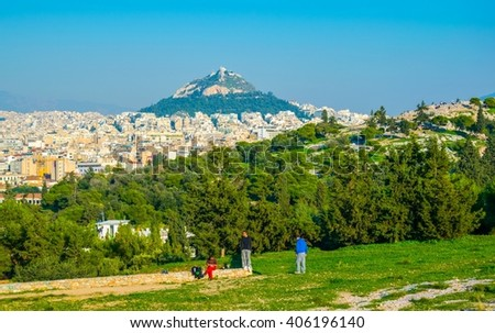 View of the lycabettus hill from the Filopappos hill in Athens, Greece. - stock photo