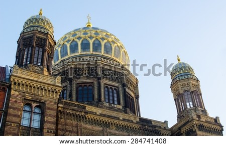 view of the main synagogue in berlin, which has a magnificent dome.