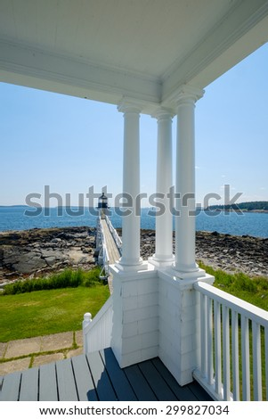 View of the Marshall Point Lighthouse from the light keepers home and porch - stock photo