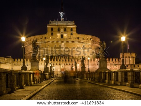 View of the Mausoleum of Hadrian, Saint Angelo castle, Castel Sant'Angelo (Castle of the Holy Angel) from the Ponte Sant'Angelo bridge in Rome, Italy with blue sky light.