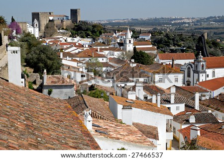 View of the medieval walled town of Obidos in western Portugal. Interesting point of view in Portugal.