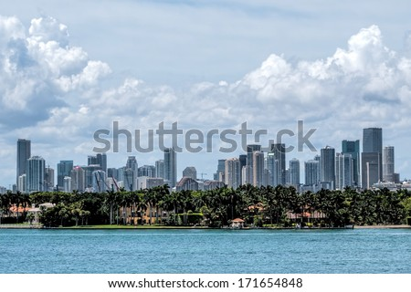 View of the Miami Skyline with offices and Apartments with a residential island in the foreground. - stock photo