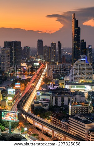 View of the midtown Bangkok city with car trail light during in sunset. - stock photo