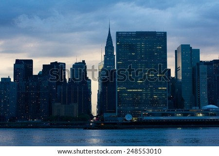 View of the Midtown Manhattan East River waterfront with the United Nations HQ in New York, NY, USA. - stock photo