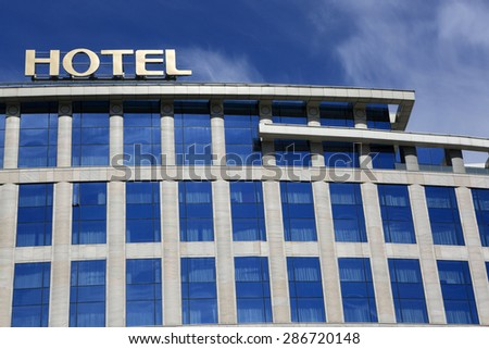 View of the modern hotel on the sky background