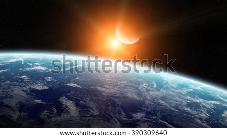 View of the moon close to planet Earth from space during a sunrise 'elements of this image furnished by NASA'