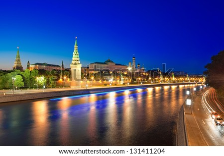 View of the Moscow Kremlin and Moskva River at night. Shot from the Big Stone Bridge.  Moscow, Russia. - stock photo