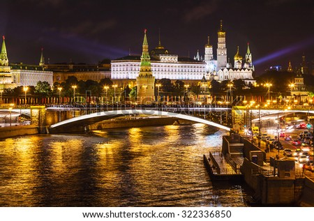 View of the Moscow Kremlin in night illumination summer evening. focus on the Kremlin Palace - stock photo