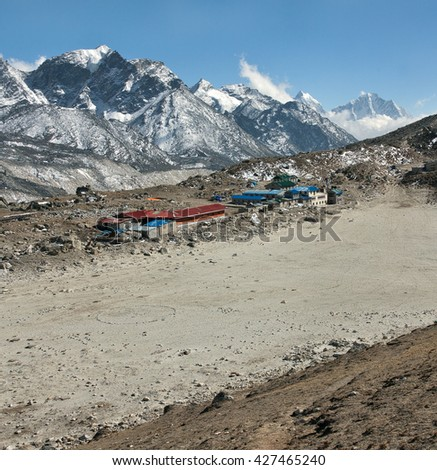View of the Mount Everest region from slope of the Kala Patthar to Gorak Shep village - Nepal, Himalayas - stock photo