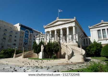 View of the National Library of Greece with the stairs and statue with modern building behind - stock photo