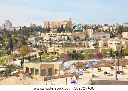 View of the New Jerusalem - modern buildings and people walking.  Walk along the walls of ancient Jerusalem. - stock photo