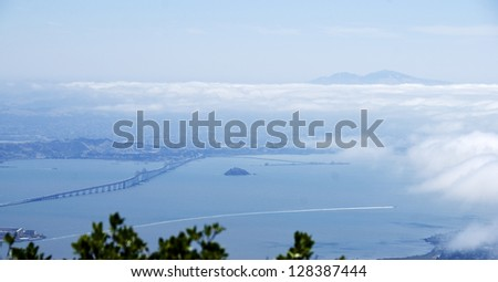 View of the north part of San Francisco Bay from the top of Mount Tamalpias in Marin County, with Mount Diablo visible above clouds on the horizon. - stock photo
