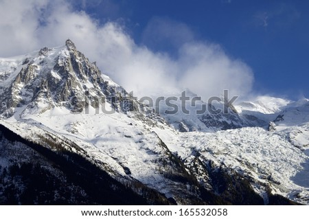view of the northern slopes of the Aiguille du Midi, at right is Mont Blanc peak, Chamonix, Alps, France - stock photo