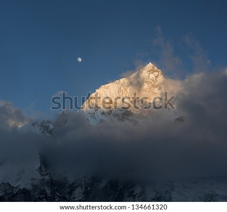 View of the Nuptse (7864 m) and full Moon from the Kala Patthar - Nepal, Himalayas