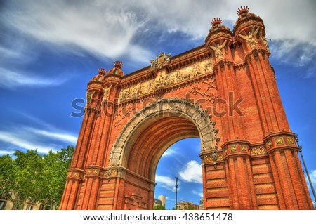 View of the of the Arc de Triomf in Barcelona, Spain on a partially cloudy spring day - colorful HDR image - stock photo