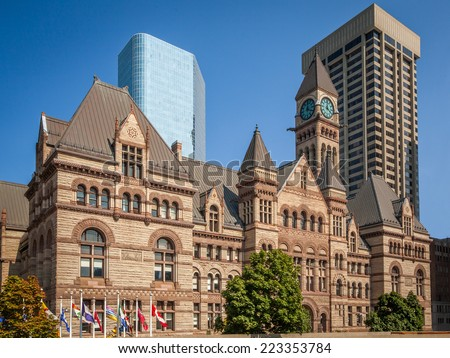 View of the old City Hall of Toronto, Canada against modern buildings - stock photo