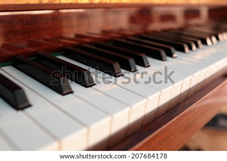 View of the old classical piano keyboard - stock photo