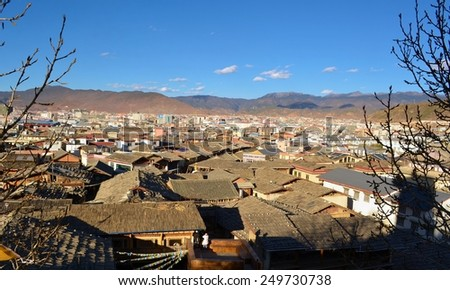 view of the old town of chinese city shangri-la alias zhongdian taken from the golden temple. - stock photo