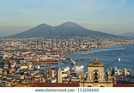 """View of the old town of Naples and the volcano """"Vesuv"""" in Italy - stock photo"""