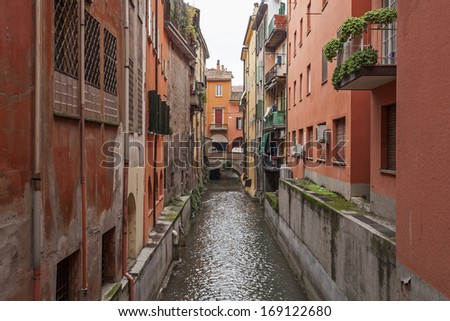 View of the old water channel in the old town of Bologna in Italy - stock photo