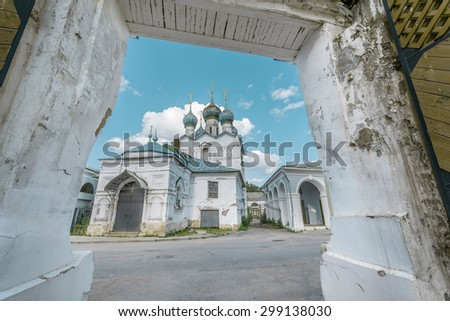View of the orthodox church through the entrance of  the Kremlin. The ancient town of Rostov The Great is a tourist center of the Golden Ring of Russia. - stock photo