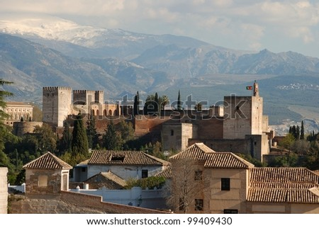 View of the Palace of Alhambra with snow capped mountains of the Sierra Nevada to the rear, Granada, Granada Province, Andalusia, Spain, Western Europe. - stock photo