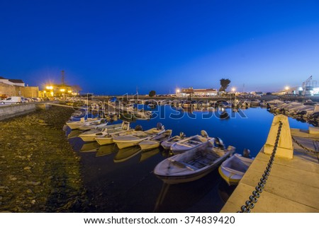 View of the peaceful marina of Faro city, Portugal at dawn.
