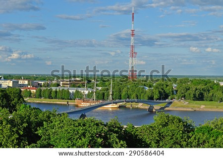 View of the pedestrian bridge over Volkhov river in Veliky Novgorod, Russia in summer - from a height