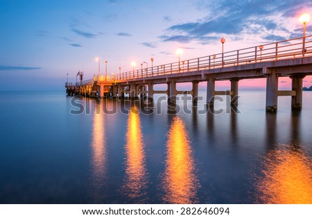 View of the pier at sunset time. - stock photo
