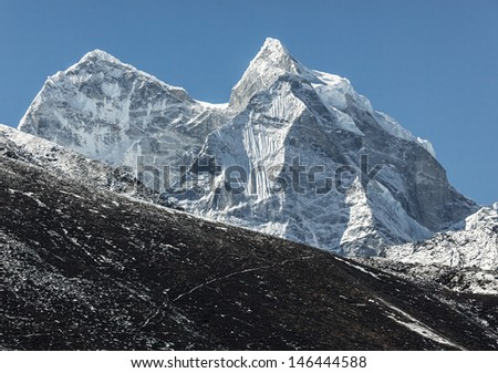 View of the Pokalde (5806 m) and Mehra Peak (5820 m) from the village of Dingboche in the valley Chhukhung - Nepal, Himalayas - stock photo