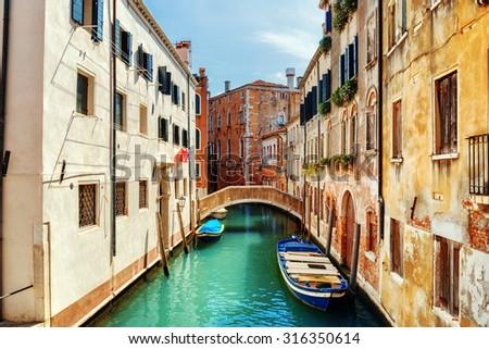 View of the Ponte de L Anatomia and the Rio de San Zan Degola Canal from the Ponte de Ruga Bella o del Forner in Venice, Italy. Venice is a popular tourist destination of Europe. - stock photo