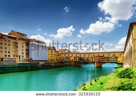 View of the Ponte Vecchio (Old Bridge) and facades of old houses on waterfront of the Arno River in Florence, Tuscany, Italy. Florence is a popular tourist destination of Europe.