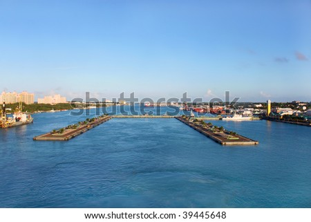 View of the port and cruise ship docks of Nassau with Paradise Island in the background in the early evening sun. - stock photo