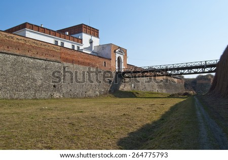 View of the ramparts of the ancient castle with inbound bridge and gate.