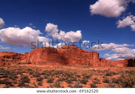View of the red rock formations in  Arches National Park with blue sky