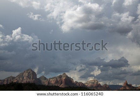 View of The Red Rocks of Sedona with pronounced cloudscape - stock photo