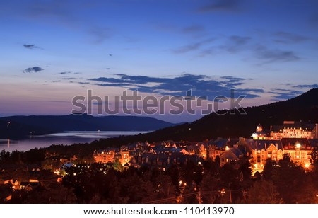 View of the resort village of Mont Tremblant at dusk - stock photo